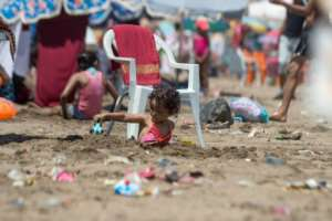 A child plays on the beach in Rabat on July 12, 2018.  By FADEL SENNA (AFP)