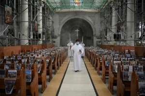 A church in the Philippines taped photos of parishioners to pews for their Sunday Easter service.  By Ted ALJIBE (AFP)