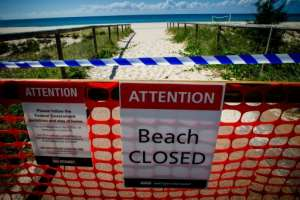 A closed sign at Coolangatta Beach on the Queensland - New South Wales border in Australia.  By Patrick HAMILTON (AFP)