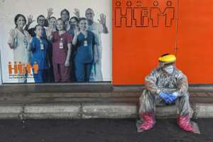 A Colombian health worker takes a break outside Medellin's General Hospital, amid the COVID-19 pandemic.  By JOAQUIN SARMIENTO (AFP)
