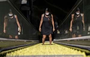 A commuter wears a face mask as she leaves a subway station in Santiago, Chile.  By MARTIN BERNETTI (AFP)