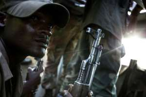A Congolese soldier on patrol for members of the ADF.  By JOHN WESSELS (AFP)