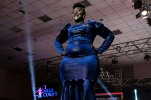 A contestant poses on a stage during the first edition of Miss Curvy Uganda in Kampala.  By SUMY SADURNI (AFP)