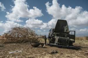 A damaged military truck belonging to Tigrayan forces lies abandoned in a field near Ayasu Gebriel, a village east of Alamata.  By EDUARDO SOTERAS (AFP)