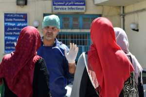 A doctor gestures outside a hospital in the Algerian town of Boufarik, as the country deals with a cholera outbreak, on August 28, 2018.  By Ryad KRAMDI (AFP)