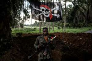 A DR Congo soldier at a military base, often targeted by the ADF militia in raids for weapons, ammunition and medical supplies.  By JOHN WESSELS (AFP)