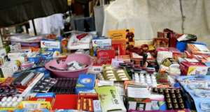 A drugs stall on a street in Lagos. Informal sales outlets are a major channel for counterfeit medicine.  By PIUS UTOMI EKPEI (AFP)