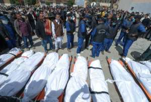 A funeral for 12 people found in mass graves in Tarhuna town, southeast of the capital.  By Mahmud Turkia (AFP)