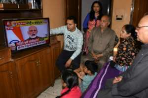A family watches Indian Prime Minister Narendra Modi's address to the nation on television at their home in Amritsar.  By NARINDER NANU (AFP)