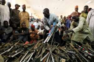 A farewell to arms? The Yansakai vigilante group surrendered hundreds of weapons last month.  By Kola Sulaimon (AFP)