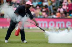 A field marshall fires an extinguisher onto a swarm of bees as the cricket match is suspended between South Africa and Sri Lanka at Wanderers cricket ground on February 4, 2017 in Johannesburg, South Africa
