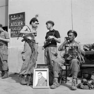 A file photo from November 1, 1956 shows Egyptian soldiers with a portrait of then president Gamal Abdel Nasser in Port Said at the height of the Suez canal crisis, after Nasser nationalised the key waterway.  By STR (FILES) (INTERCONTINENTALE/AFP/File)
