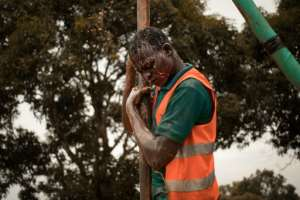 A former child soldier works on drilling a borehole in Bangui, part of a vocational programme for young victims of the Central African Republic's long conflict.  By FLORENT VERGNES (AFP)