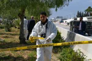 A forensic expert seals off the scene of the explosion near the US embassy in Tunis.  By Fethi Belaid (AFP)
