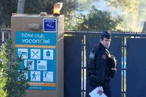 A French gendarme walks at the entrance of a holiday resort near Marseille, France, where French citizens evacuated from Wuhan, China, are expected to be put under quarantine for 14 days.  By GERARD JULIEN (AFP)
