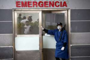 A guard stands at the entrance of the emergency room of a hospital in Santo Domingo, Dominican Republic.  By Erika SANTELICES (afp/AFP)