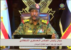 A grab from a broadcast on Sudanese TV shows General Abdel Fattah al-Burhan addressing the nation on Saturday.  By - (Sudan TV/AFP)