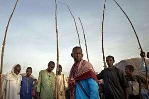 A group of Fulani men at a camp for internally displaced people in Bamako. More than 1,200 people who fled their villages in central Mali live at the camp, where conditions don't allow for social distancing or other preventative measures.  By MICHELE CATTANI (AFP)