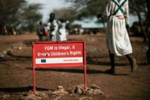 A growing international campaign seeks to stamp out female genital mutilation (FGM) -- this sign is in Katabok village, northeastern Uganda.  By Yasuyoshi CHIBA (AFP)