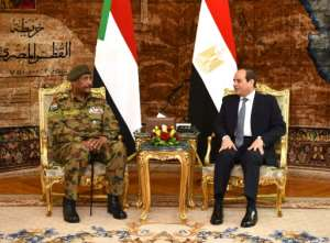 A handout picture released by the Egyptian Presidency on May 25, 2019 shows Egyptian President Abdel Fattah al-Sisi (R) meeting with Lieutenant General Abdel Fattah al-Burhan, chief of Sudan's ruling military council, in the capital Cairo.  By STRINGER (EGYPTIAN PRESIDENCY/AFP/File)