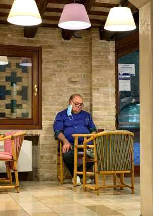 A photo of dejected restaurant owner Giuseppe Tonon went viral in Italy.  By Handout (Elena Tonon/AFP)