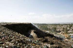 A photo taken March 12, 2017 shows a view of the main landfill of Addis Ababa on the outskirts of the city, where Ethiopia has built a power plant to convert waste into energy.  By ZACHARIAS ABUBEKER (AFP/File)