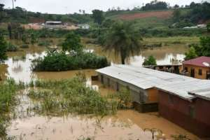 A picture shows flooded houses near the site of a landslide that killed at least 13 people in Anyama, near Abidjan..  By SIA KAMBOU (AFP)