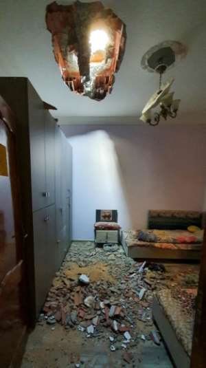 A picture shows the debris inside a room following a rocket blast in Tripoli's southern district of Hadhba al-Badri on January 28.  By Mahmud TURKIA (AFP/File)