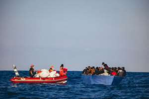 A picture released by German migrant rescue NGO Sea-Eye shows an operation to rescue people in distress off the Libyan coast in April.  By Cedric FETTOUCHE (sea-eye.org/AFP)