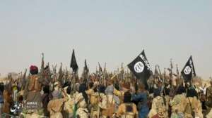 A picture released last May by Islamic State's Aamaq News Agency purporting to show fighters celebrating after an attack on an army patrol in Niger. Its authenticity cannot be verified.  By HO (AAMAQ NEWS AGENCY/AFP)