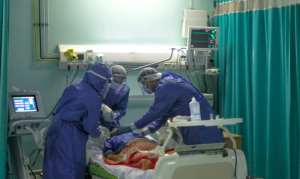 A picture taken by a doctor at a Cairo hospital on April 29 shows medical staff intubating a coronavirus patient.  By YAHYA DIWER (AFP/File)