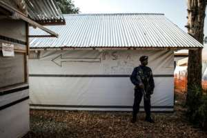 A police officer (pictured March 9, 2019) stands guard inside an Ebola Treatment Centre in Butembo, North Kivu province, where the WHO says there are clear signs the spread of the virus was