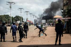 A police officer throws a stone at protesters during a mass protest on Wednesday.  By JOHN WESSELS (AFP/File)
