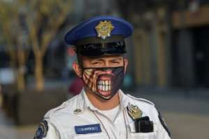 A policeman wearing a face mask in Mexico City.  By PEDRO PARDO (AFP)