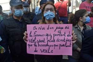 A protester demonstrating against femicide in Algeria held a sign reading in French,
