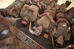 A quick lie-down: Soldiers grab a few moments' respite.  By MICHELE CATTANI (AFP)