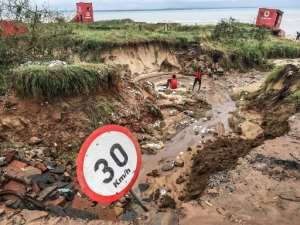 A road in Pemba destroyed by flooding in the provincial capital of Pemba.  By STRINGER (AFP)