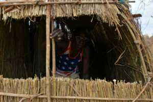 A straw hut provides the quarters for this soldier.  By TONY KARUMBA (AFP)