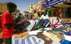 A street vendor displays shirts at a market in the Sudanese capital Khartoum.  By ASHRAF SHAZLY (AFP)