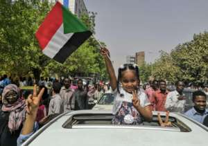 A Sudanese girl flashes the victory sign as celebrations grip the capital Khzartoum even before the army makes its much heralded announcement.  By - (AFP)