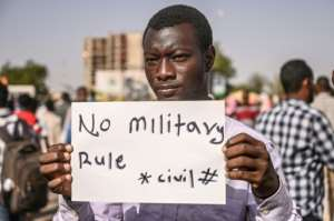 A Sudanese protester during a sit-in outside the army headquarters in the capital Khartoum on Monday, as demonstrators kept up the pressure on the ruling military council.  By OZAN KOSE (AFP)