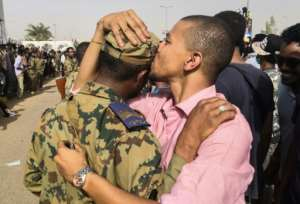 A Sudanese protester kisses a soldier on the head outside army headquarters as expectations mount that the army is taking the side of the protest movement. By - (AFP)