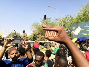 A Sudanese protester outside army headquarters shows bullet cartridges he has collected -- the National Intelligence and Security Service and riot police have cracked down on demonstrators, but the army has not intervened.  By STRINGER (AFP)