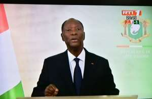 A screen shot showing resident Alassane Ouattara addressing the nation on Monday.  By ISSOUF SANOGO (AFP)