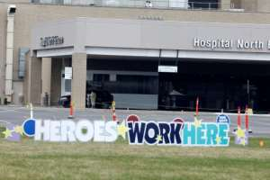 A sign praising health workers at Beaumont Hospital Royal Oak Campus in Royal Oak, Michigan. By JEFF KOWALSKY (AFP)
