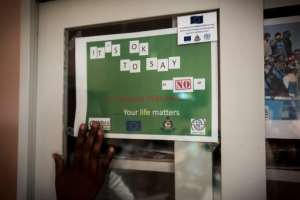 A sign that is part of a campaign to stop illegal migration from Ghana to Libya and Europe and to promote safe migration reads 'It's okay to say no to irregular migration'..  By CRISTINA ALDEHUELA (AFP)