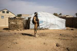 A soldier in northern Burkina Faso patrols a camp for people displaced by the violence. Five percent of the country's population has fled their home.  By OLYMPIA DE MAISMONT (AFP/File)