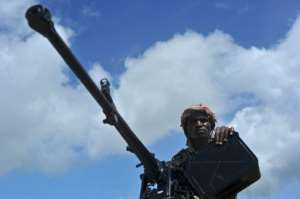 A Somali soldier holds a machine gun at a military base in this 2018 file photo.  By Mohamed ABDIWAHAB (AFP/File)