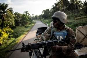 A South African UN peacekeeper with the MONUSCO mission on patrol in the eastern DR Congo town of Oicha.  By JOHN WESSELS (AFP)