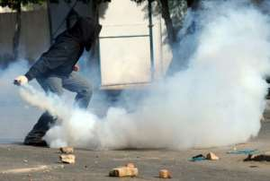 A Tunisian demonstrator prepares to throw a tear-gas canister during clashes with security forces in Regueb, near Sidi Bouzid in January 2011 -- the uprising in Tunisia signalled the start of the Arab Spring.  By STR (AFP/File)